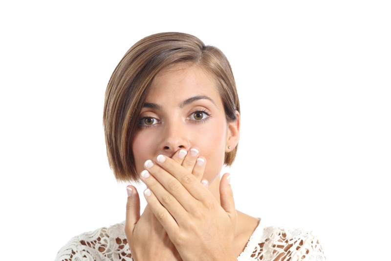 woman hiding large front teeth