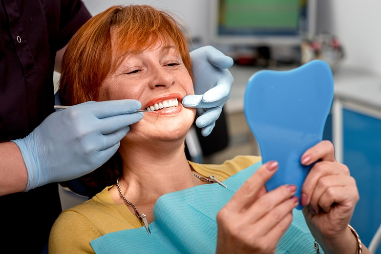 A woman getting her smile adjusted while at the dentist
