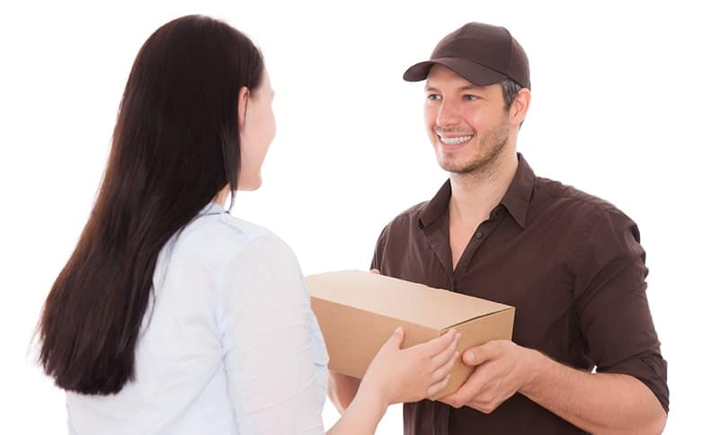 UPS Delivery Driver handing a package to a woman. Amazon recently had to pull a Teeth whitening product from it's warehouses