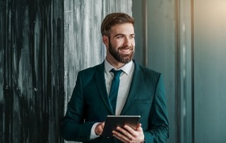 Attractive business man takes a break from working on his iPad