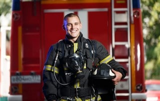 emergency firefighter shows off his smile